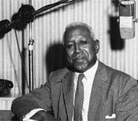George S. Schuyler, in a radio studio in his sixties